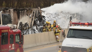 In this Nov. 14, 2018 file photo, firefighters work to extinguish a fire in a tractor-trailer accident on I-78 at mile marker 33.4 in Windsor Township that killed two people who were driving to their wedding. (Bill Uhrich/Reading Eagle via AP, File)