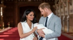 Prince Harry and Meghan, Duchess of Sussex, during a photocall with their newborn son, on May 8, 2019. (Dominic Lipinski / Pool via AP)