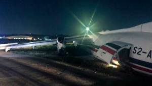 In this handout photo provided by Myanmar Department of Civil Aviation, the Biman Bangladesh Airline plane is seen after an incident in Yangon International airport, Wednesday, May 8, 2019, in Yangon, Myanmar. (AP Photo/Aye Win Myint)