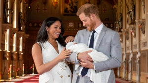 Prince Harry and Meghan, Duchess of Sussex, during a photocall with their newborn son, in St George's Hall at Windsor Castle, Windsor, south England, Wednesday May 8, 2019. (Dominic Lipinski/Pool via AP)