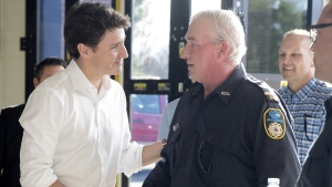 Prime Minister Justin Trudeau meets with volunteers and first responders at a community barbecue in Bracebridge Ontario on Wednesday May 8, 2019. THE CANADIAN PRESS/Fred Thornhill
