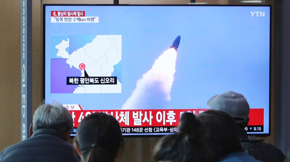 People watch a TV showing file footage of North Korea's missile launch during a news program at the Seoul Railway Station in Seoul, South Korea, Thursday. (AP Photo/Ahn Young-joon)