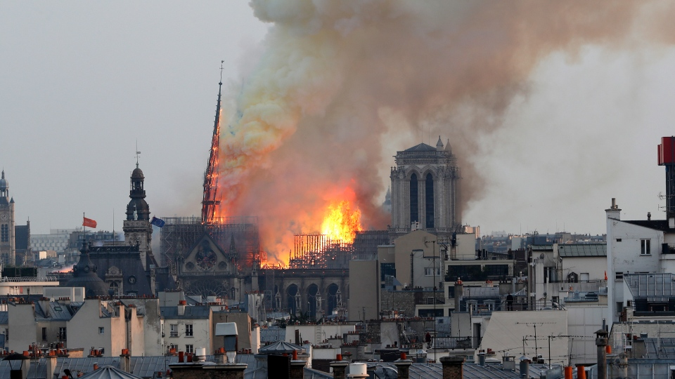 FILE. In this April 15, 2019 file photo, flames rise from Notre Dame cathedral as it burns in Paris. (AP Photo/Thibault Camus)