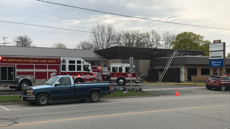 Fire crews are on scene after a fire at Athena's Diner in Wyoming, Ont. on Thursday, May 9, 2019. (Sean Irvine / CTV London)