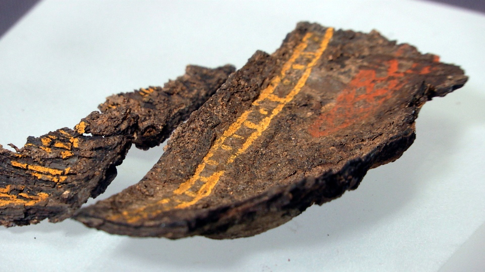 A painted wooden box fragment, claimed to be the only surviving example of early Anglo-Saxon painted woodwork, on display at Southend Central Museum in Southend, England, Thursday, May 8, 2019. (AP Photo/James Brooks)