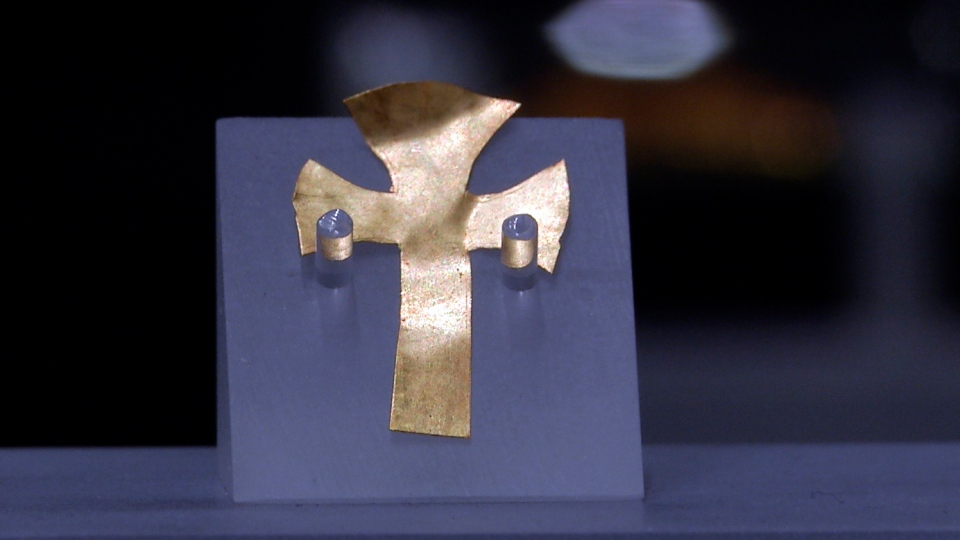 A gold foil cross uncovered at an Anglo-Saxon burial site in the village of Prittlewell in 2003 on display at Southend Central Museum in Southend, England, Thursday, May 8, 2019. (AP Photo/James Brooks)