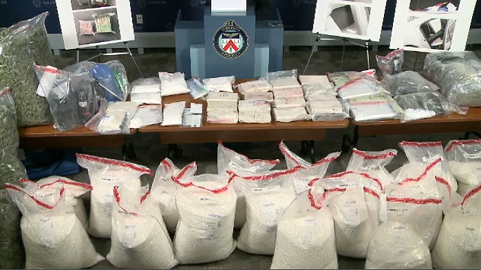 Toronto police display some of the items allegedly seized during