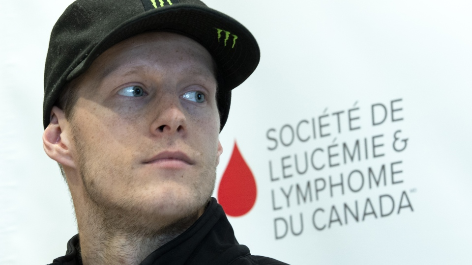 Olympic snowboarder Max Parrot, diagnosed with Hodgkin's lymphoma, listens to introductions while making an announcement with the Leukemia and Lymphoma Society of Canada in Montreal on Thursday, May 9, 2019. THE CANADIAN PRESS/Paul Chiasson