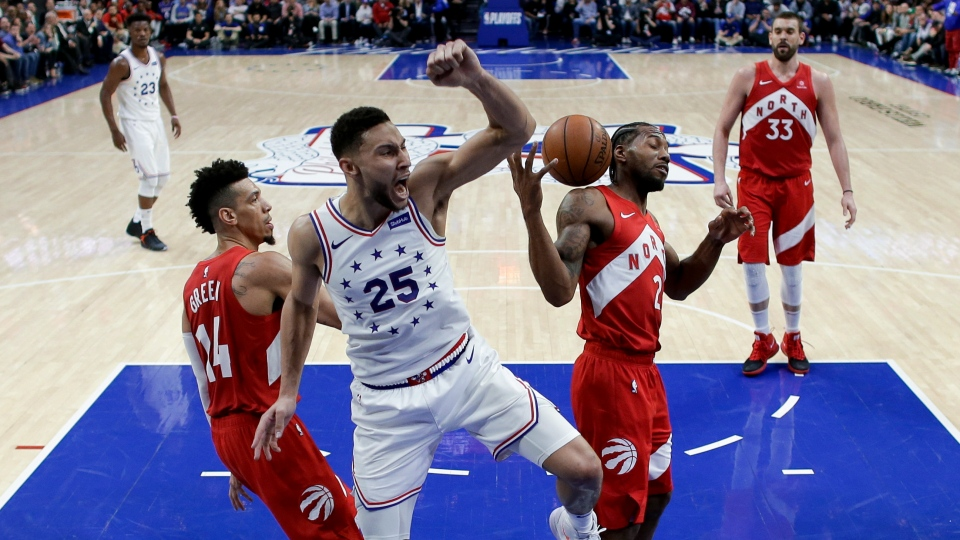 d3dd27fd150 Philadelphia 76ers  Ben Simmons (25) reacts after dunking the ball between Toronto  Raptors  Danny Green (14) and Kawhi Leonard (2) during the second half of  ...