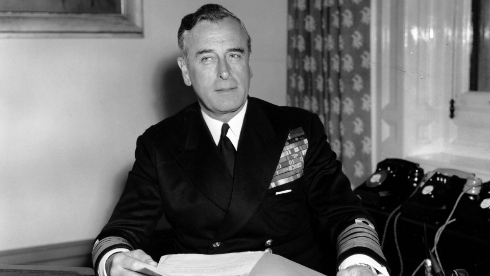 In this April 22, 1955 file photo, British Admiral Earl Louis Mountbatten sits at his desk in full uniform for the first time at the Admirality in London. (AP Photo)