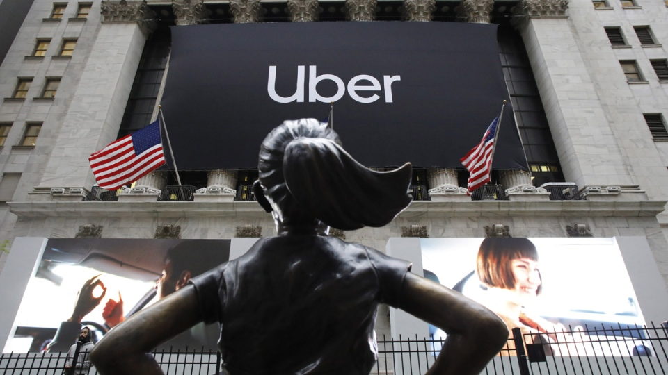 The statue of Fearless Girl stands in front of the New York Stock Exchange before Uber holds its initial public offering, on May 10, 2019. (Mark Lennihan / AP)