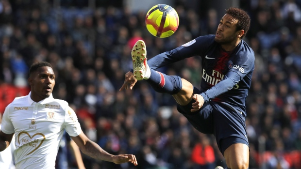 PSG's Neymar, right, controls the ball