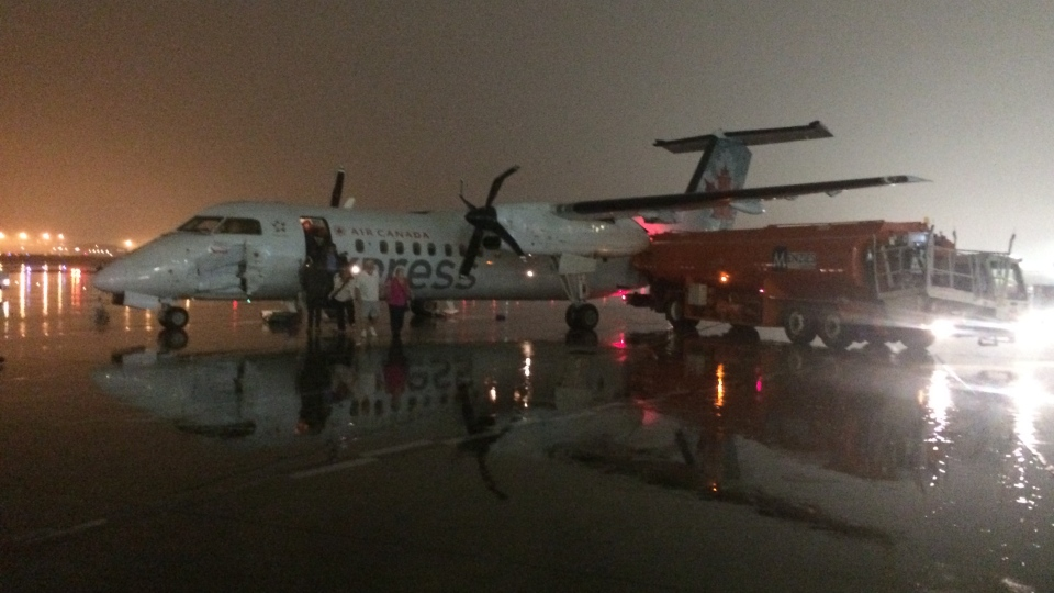 Air Canada Express flight evacuated in Toronto after being hit by a fuel truck. (Daniel Demers)
