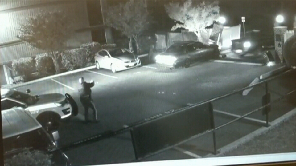 Surveillance video shows two vehicles allegedly trying to evade police in the parking lot of a Surrey townhouse complex on Monday, May 6, 2019.