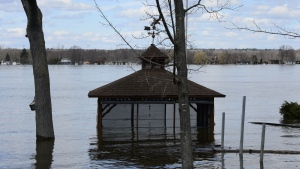 A gazebo sits under water on the Ottawa River in Cumberland, Ontario on Tuesday, April 30, 2019. (THE CANADIAN PRESS/Sean Kilpatrick)