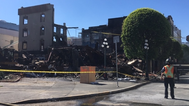 City crews survey the rubble of the Plaza Hotel in downtown Victoria Fri., May 10, 2019. (CTV Vancouver Island)