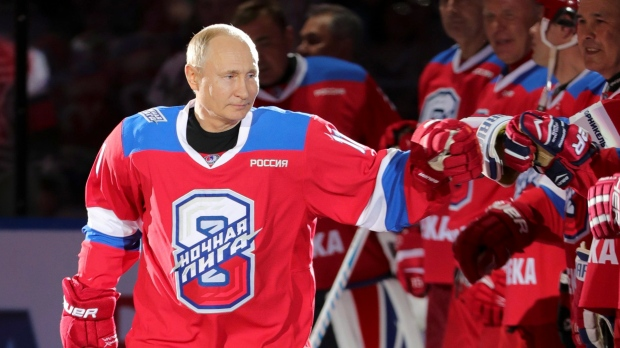 Image result for Russian President Vladimir Putin greets his teammates prior to a hockey match at the Bolshoi Arena