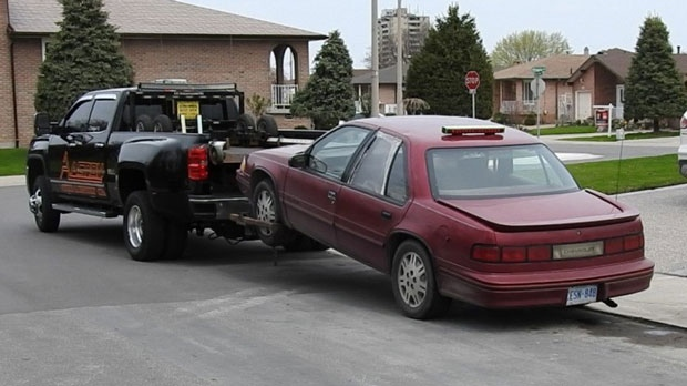 A 1991 red Chevrolet Lumina is seized in connection with a series of break-and-enters in Hamilton. (Police handout)