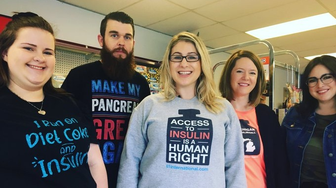 Jillian Rippolone (centre) and a group out of Michigan advocating for access to insulin visit Windsor's Yee Pharmacy to buy insulin in Canada at a tenth the cost of product in the U.S. on May 9, 2019. (Ricardo Veneza/CTV Windsor)