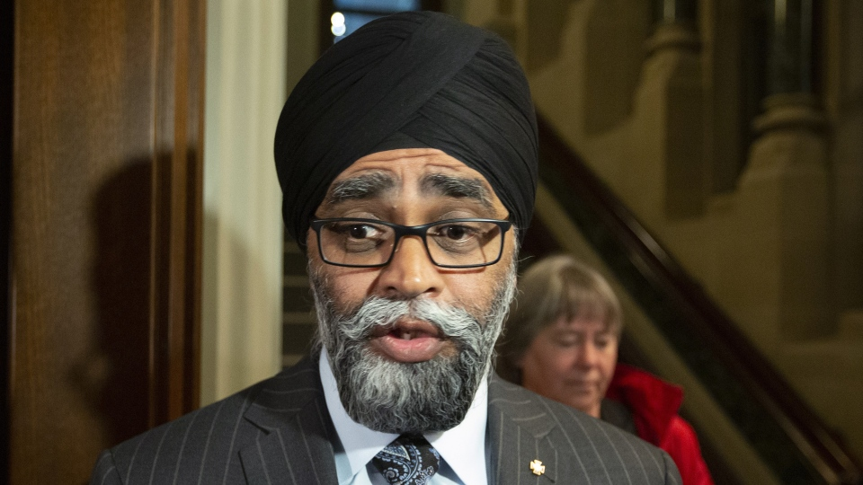 Minister of National Defence Minister Harjit Sajjan stops to talk to reporters as he makes his way to a meeting with caucus in Ottawa on Wednesday, May 8, 2019. THE CANADIAN PRESS/Fred Chartrand