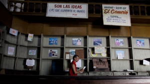 In this Oct. 9, 2009 file photo, an employee works in a government food store with empty shelves in Havana, Cuba. (AP Photo/Javier Galeano, File)
