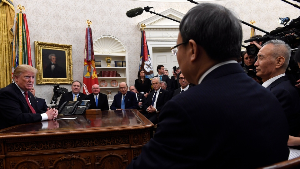 In this Jan. 31, 2019, file photo U.S. President Donald Trump, left, meets with Chinese Vice Premier Liu He, far right, at the White House in Washington. (AP Photo/Susan Walsh, File)
