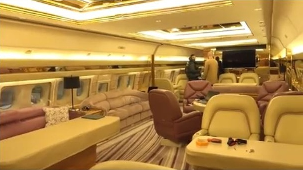 The interior of Drake's new private jet, decked out with plush seating, tables, striped carpet and a giant flat-screen TV. (Champagnepapi/Instagram)