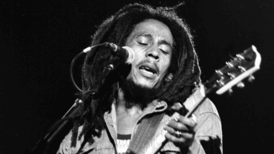 FILE - In this July 4, 1980 file photo, Jamaican singer Bob Marley performs at a reggae festival concert in Paris. (AP Photo)