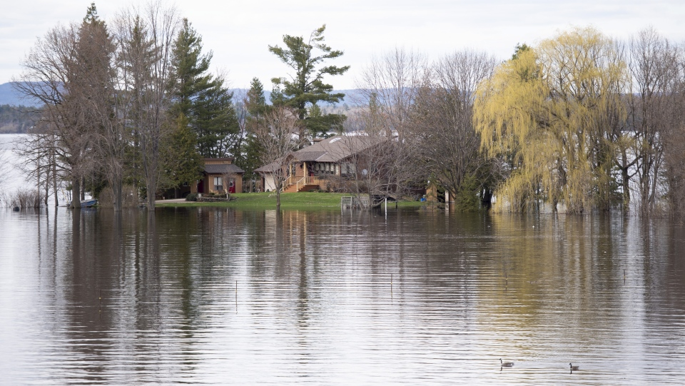 A home off of Beachburg Road by the Ottawa River in Whitewater Region, east of Pembroke, Ontario is completely surrounded by water as flooding continues in the region, on Saturday, May 11, 2019. (THE CANADIAN PRESS/Justin Tang)