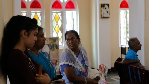 Sri Lankan Catholic devotees attend Sunday Mass at a church in Colombo, Sri Lanka, Sunday, May 12, 2019. The Catholic Church in Sri Lanka has held the first regular Sunday Mass since the Easter suicide bombings of churches and hotels killed more than 250 people. (AP Photo/Eranga Jayawardena)