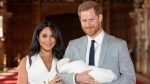 Britain's Prince Harry and Meghan, Duchess of Sussex, during a photocall with their newborn son, in St George's Hall at Windsor Castle, Windsor, south England on May 8, 2019. (THE CANADIAN PRESS/AP, Dominic Lipinski - POOL)