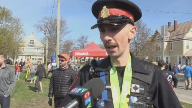 Weyburn, Saskatchewan Police Constable Jeff Bartsch ran 10k in Sunday's Fredericton Marathon in memory of the victims of last August's fatal shooting.