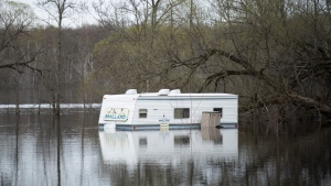 A mobile home is submerged under flood waters at a property in the Whitewater Region, east of Pembroke, Ontario as flooding continues in the region, on Saturday, May 11, 2019. THE CANADIAN PRESS/Justin Tang