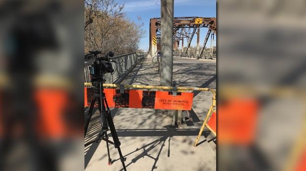 5ec069ae1c3a08 Louise Bridge sidewalk barricaded due to large holes