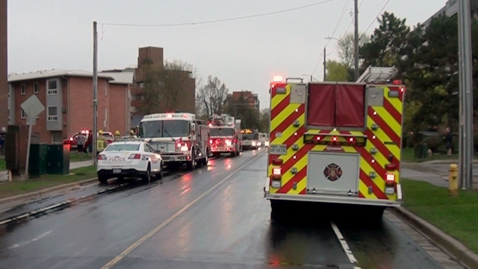 Emergency crews are seen at the scene of a deadly fire in Oshawa on May 12, 2019.