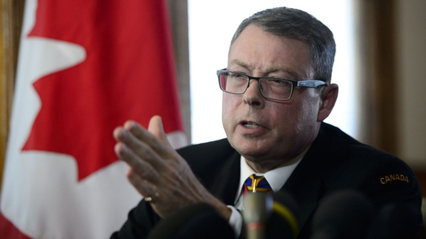 Vice Admiral Mark Norman reacts