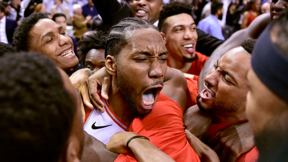 Toronto Raptors forward Kawhi Leonard (2) celebrates his last-second basket with teammates at the end of second half NBA Eastern Conference semifinal action against the Philadelphia 76ers, in Toronto on Sunday, May 12, 2019. THE CANADIAN PRESS/Frank Gunn
