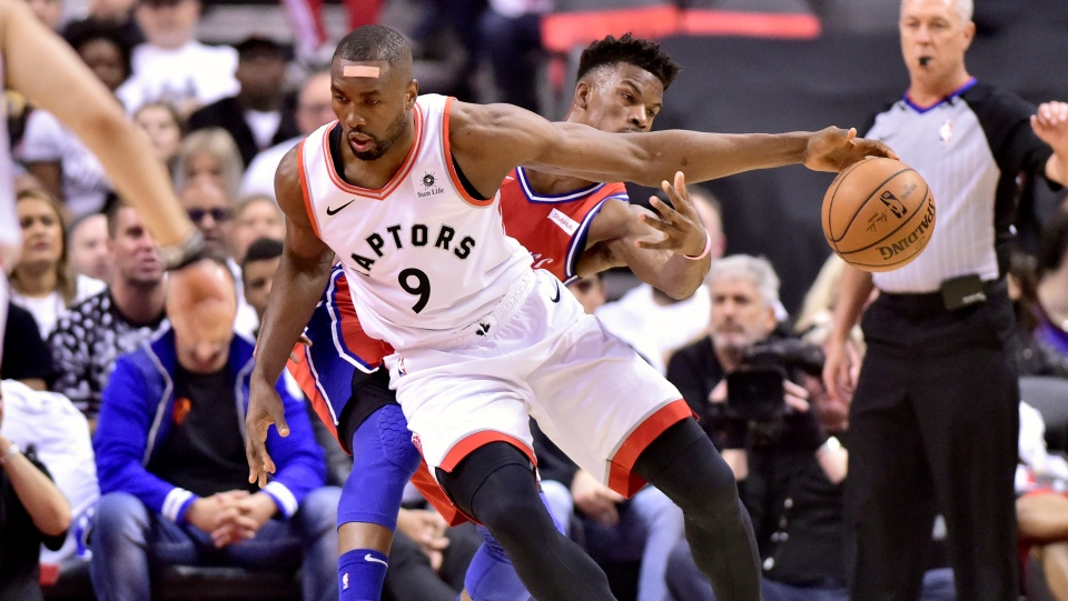 Philadelphia 76ers guard Jimmy Butler (23) fails to intercept as Toronto Raptors centre Serge Ibaka (9) moves the ball down the court during first half NBA Eastern Conference semifinal action in Toronto on Sunday, May 12, 2019. THE CANADIAN PRESS/Frank Gunn