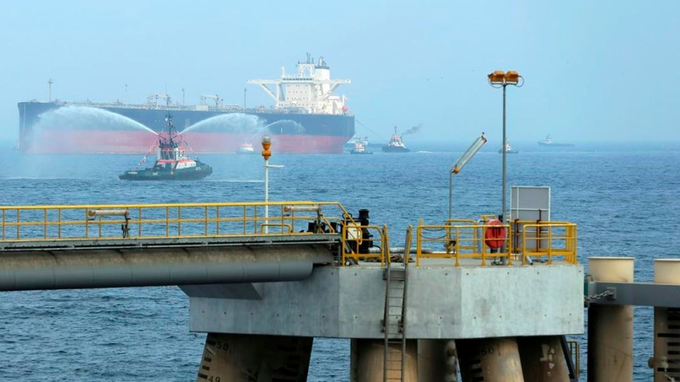"""FILE - In this Sept. 21, 2016 file photo, an oil tanker approaches to the new Jetty during the launch of the new $650 million oil facility in Fujairah, United Arab Emirates. The United Arab Emirates said Sunday, May 12, 2019 that four commercial ships near Fujairah """"were subjected to sabotage operations"""" after false reports saying there had been explosions at the Fujairah port. (AP Photo/Kamran Jebreili)"""