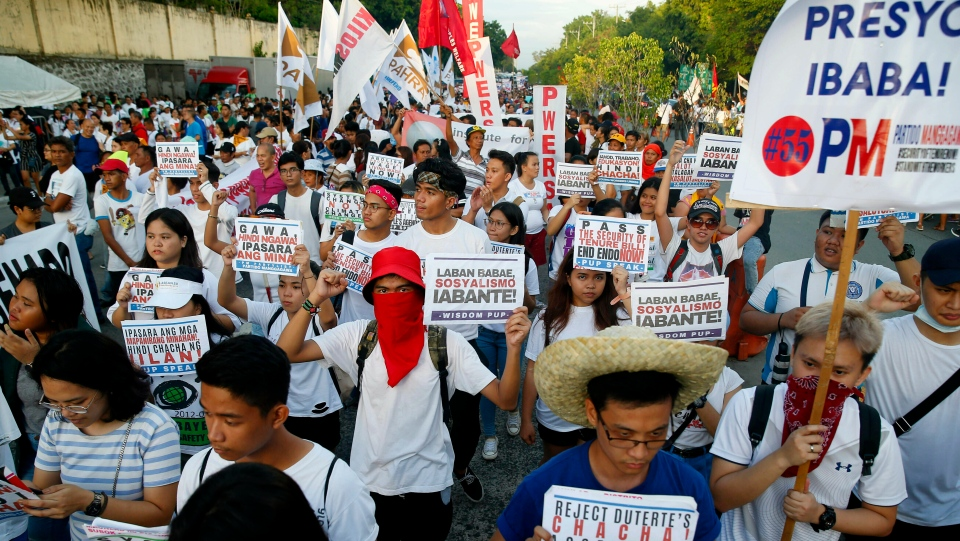 Activists march during a rally at the People Power Monument in support of opposition senatorial candidates three days before the May 13 midterm elections that would elect twelve senators, more than two hundred congressmen as well as local leaders Friday, May 10, 2019 in suburban Quezon city northeast of Manila, Philippines. (AP Photo/Bullit Marquez)