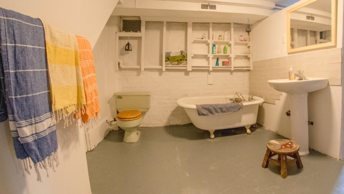 """The sole bathroom in the """"Lil Yellow House"""" is located in the basement. (Arty Basinski/Real Estate by Bike)"""