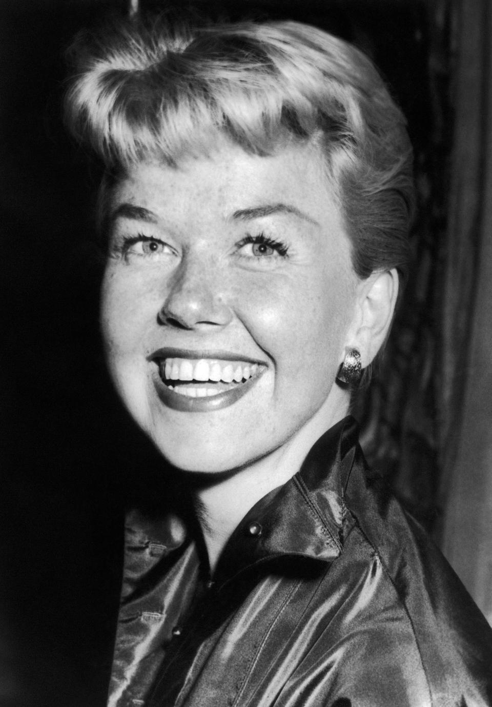 Film actress and singer Doris Day smiles in London, April 12, 1955. (AP Photo/Bob Dear)