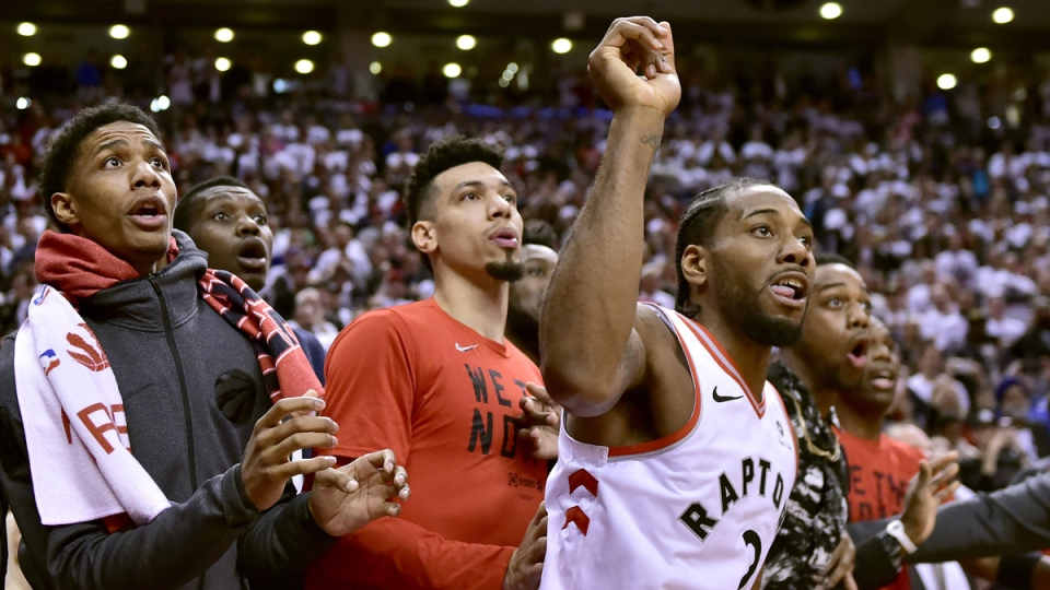 Toronto Raptors forward Kawhi Leonard (2) and teammates watch as the ball bounces around the rim on May 12, 2019. (Frank Gunn / The Canadian Press)