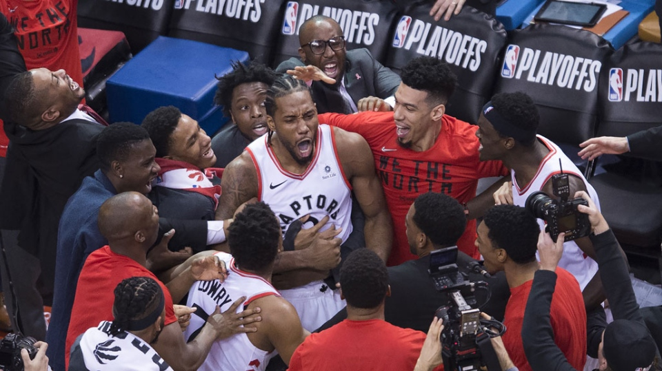 Toronto Raptors forward Kawhi Leonard (2) reacts with teammates after making the buzzer beating shot to defeat the Philadelphia 76ers at the end of second half Eastern Conference semifinal NBA playoff basketball action in Toronto on Sunday, May 12, 2019. (THE CANADIAN PRESS/Nathan Denette)