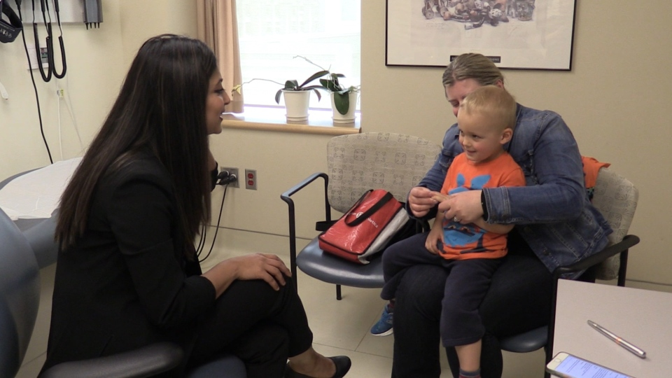 Dr. Samiry Jeimy, left, speaks with Luke and his mom Kelly Straatman, in London, Ont. on Monday, May 13, 2019. (Celine Moreau / CTV London)
