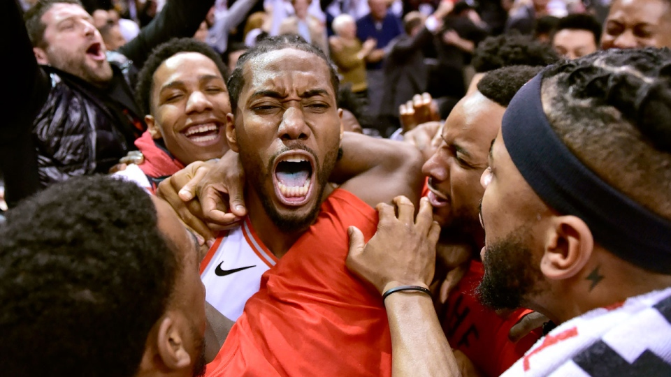 Toronto Raptors forward Kawhi Leonard (2) celebrates his last-second basket at the end of second half NBA Eastern Conference semifinal action against the Philadelphia 76ers, in Toronto on Sunday, May 12, 2019. THE CANADIAN PRESS/Frank Gunn