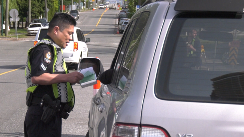 A police officer hands out a ticket as authorities crack down on bad drivers in construction zones on May 13, 2019.