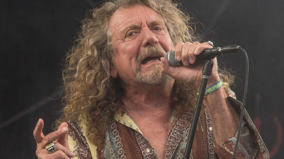 Robert Plant performs on the Pyramid main stage at Glastonbury music festival, in England, June 28, 2014. (Photo by Joel Ryan/Invision/AP)
