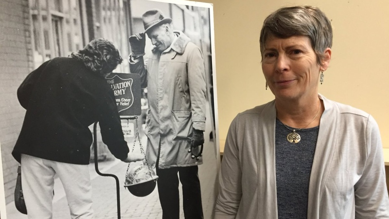 Fred Kingsmill's daughter-in-law, Laurie Kingsmill, stands in front of his photo in London, Ont. on Monday, May 13, 2019. (Adrienne South / CTV London)