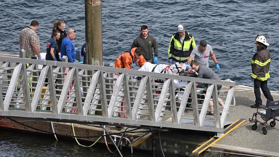 Emergency response crews transport an injured passenger to an ambulance at the George Inlet Lodge docks, Monday, May 13, 2019, in Ketchikan, Alaska. (Dustin Safranek/Ketchikan Daily News via AP)